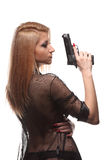 Elegant fashionable woman with a gun in hands Stock Image