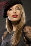 Elegant fashionable woman in a hat Stock Image