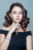 Elegant fashionable woman with jewelry. Beautiful woman with expensive pendant. Jewellery and accessories. Stock Image