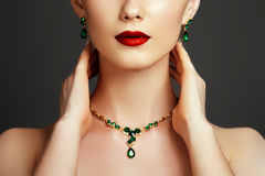 Elegant fashionable woman with jewelry. Fashion concept. Elegant fashionable woman with jewelry. Beautiful woman with emerald necklace. Young beauty model with stock photos