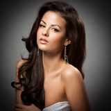 Elegant fashionable woman with silver jewelry stock image