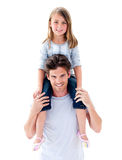 Elegant father giving his daughter piggyback ride Stock Photography