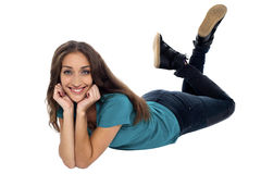 Elegant female with cheeky expression relaxing on the floor Stock Photos