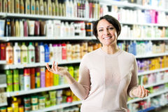 Elegant female customer buying conditioner for hair Royalty Free Stock Photography
