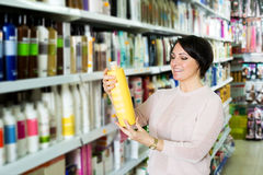 Elegant female customer buying conditioner for hair Stock Photo