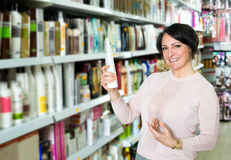 Elegant female customer buying conditioner for hair Royalty Free Stock Images