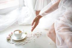 Elegant female hand with fine manicure pulling stock photography