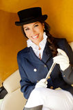 Elegant female jockey smiling Stock Photography