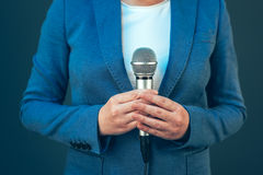 Elegant female journalist conducting business interview or press Royalty Free Stock Photo