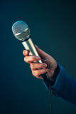 Elegant female journalist conducting business interview or press. Conference, hand with microphone Royalty Free Stock Images