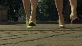Elegant female legs in high heels walking on street stock video