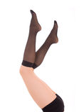 Elegant female legs in socks Royalty Free Stock Photography