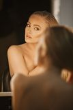 Elegant female photo model looking in mirror Stock Photo