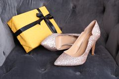 Elegant female shoes and gift box Royalty Free Stock Images