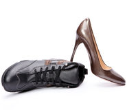 Elegant female shoes and Men's boots Royalty Free Stock Photo