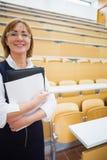 Elegant female teacher in lecture hall Stock Photos
