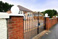 Elegant fence outside British house Stock Photo