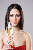 Elegant festive champagne girl. Royalty Free Stock Photos