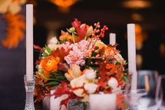 Elegant festive table. Luxury wedding decorations with bench, candle and flowers composition on ceremony place Royalty Free Stock Images