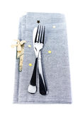 Elegant Festive table setting place with fork and knife on a gre Stock Images