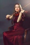Elegant fiddle player Stock Photo