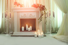Elegant fireplace with candles Stock Photography