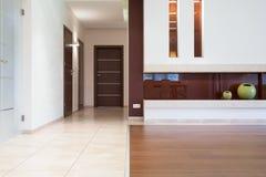 Elegant floors at modern flat. Elegant white and oak floors at modern flat Royalty Free Stock Photography