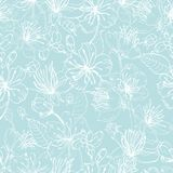 Elegant floral seamless pattern with tender blooming flowers of Japanese sakura tree hand drawn with white lines on blue. Background. Vector illustration for Stock Images