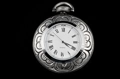 Elegant flower pocket watch. Elegant flower carved steel pocket watch isolated on black Royalty Free Stock Image