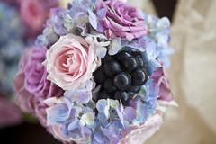Elegant flowers bouquet composition. With pink roses, blue hydrangea and grapes Royalty Free Stock Photo