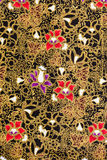 Elegant Flowers Patterns on Thai Silk Fabric. Very beautiful and elegant Thai style flower patters on silk fabric in black and gold Stock Photos