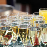 Elegant flutes filled with champagne Royalty Free Stock Images
