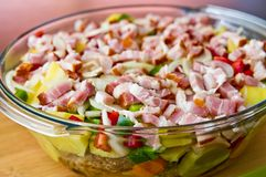 Elegant food photo of potato, pork and bacon baked dish royalty free stock photo