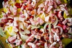 Elegant food photo of potato, pork and bacon baked dish stock photo