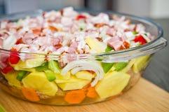 Elegant food photo of potato, pork and bacon baked dish royalty free stock images