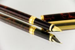 Elegant fountain pen reflecting on glass surface royalty free stock photos