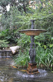 Elegant fountain with statues in the garden of Monaco Royalty Free Stock Images