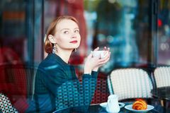 Elegant French woman in Parisian cafe Royalty Free Stock Images