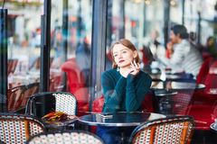 Elegant French woman in Parisian cafe Royalty Free Stock Photo