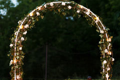 Elegant fresh floral wedding aisle archway with leaves flowers a Stock Photo