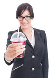 Elegant and friendly woman offering healthy red juice Royalty Free Stock Image