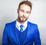 Elegant & friendly young handsome man in costume. Studio fashion portrait. Stock Photo