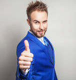 Elegant & friendly young handsome man in costume. Studio fashion portrait. Stock Photography