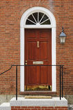 Elegant Front Door in a Brick Building Stock Images