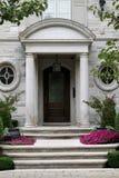 Elegant front door with flowers Royalty Free Stock Photos