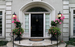 Elegant front door with flowers Royalty Free Stock Photos