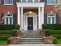 Elegant front porch. Elegant  portico entrance of large house Stock Photos