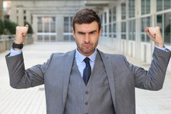Elegant funny businessman flexing his muscles.  Royalty Free Stock Photo