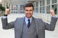 Elegant funny businessman flexing his muscles.  Stock Images