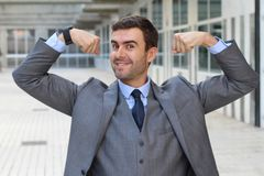 Elegant funny businessman flexing his muscles.  Royalty Free Stock Photography